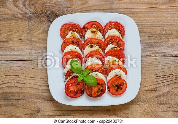 Caprese salad tomato mozzarella with basil - csp22482731