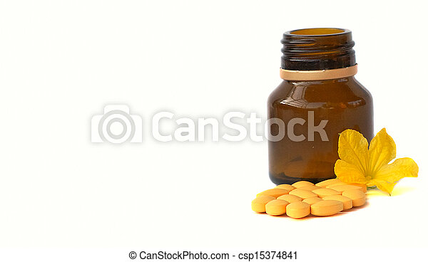 Capsules Pills Bio Medicine and Bottle with flower isolated on white background - csp15374841
