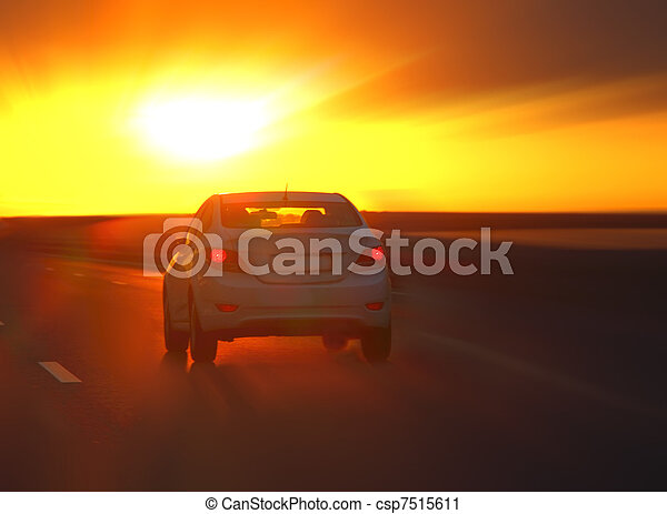 car at sunset on the highway - csp7515611