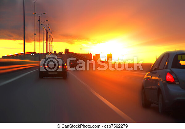 car at sunset on the highway - csp7562279