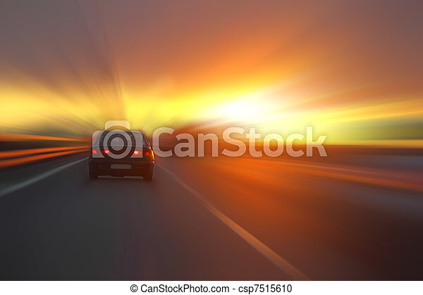 car at sunset on the highway - csp7515610