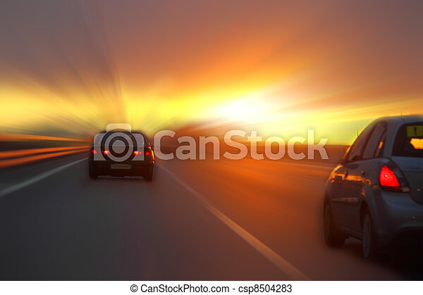 car at sunset on the highway - csp8504283
