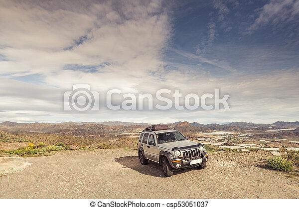 Car by roadside in wildernes. - csp53051037