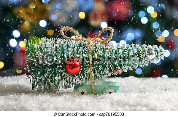 Car Carrying A Christmas Tree - csp76195503