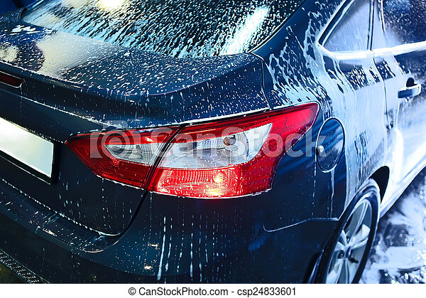 car covered with foam on car wash - csp24833601