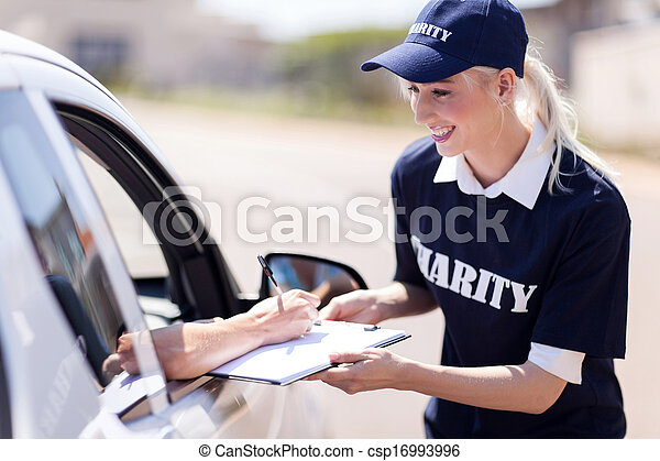 car driver signing a donation papers for charity - csp16993996