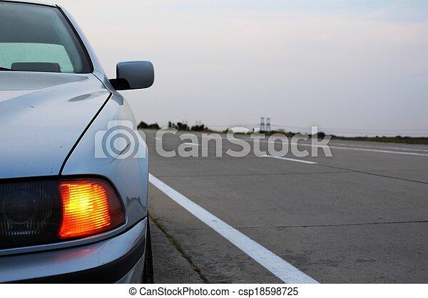 Car emergency lights at roadside - csp18598725