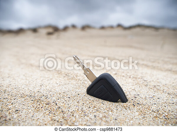 Car key in the sand - csp9881473