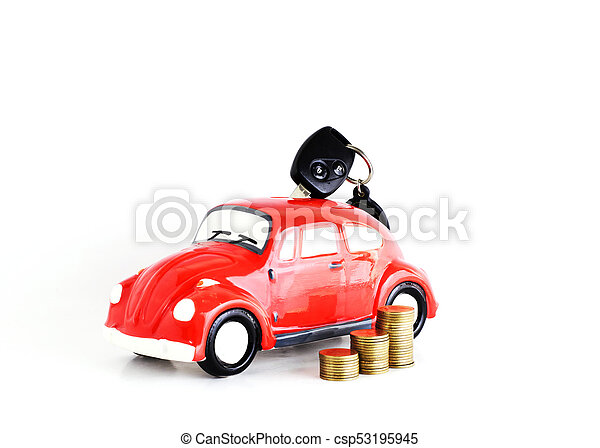 Car key into Car bank and coins stack on white background for loans concept - csp53195945