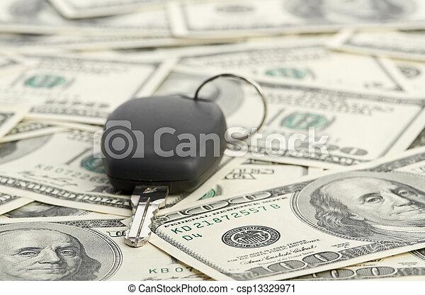 Car Key on 100 dollar background - csp13329971