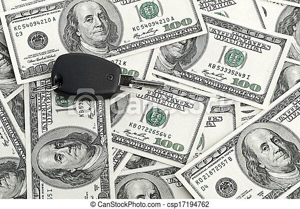 Car Key on 100 dollar background - csp17194762