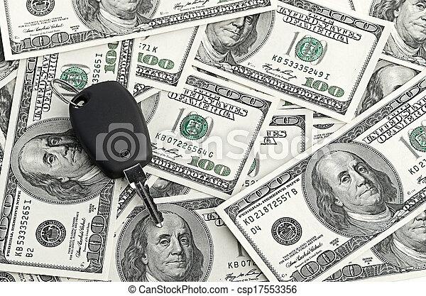 Car Key on 100 dollar background - csp17553356