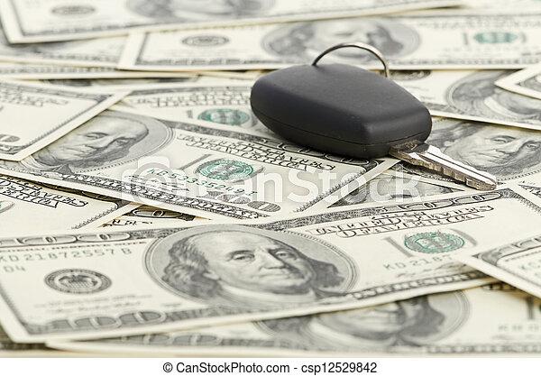 Car Key on 100 dollar background - csp12529842