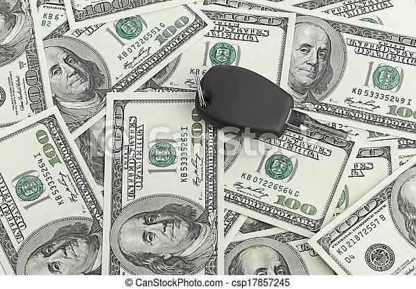 Car Key on 100 dollar background - csp17857245