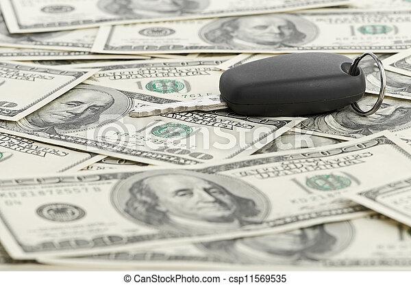 Car Key on 100 dollar background - csp11569535