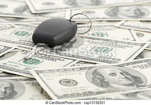 Car Key on 100 dollar background - csp13132331