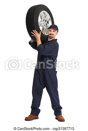 Car mechanic with a tire. - csp31397713
