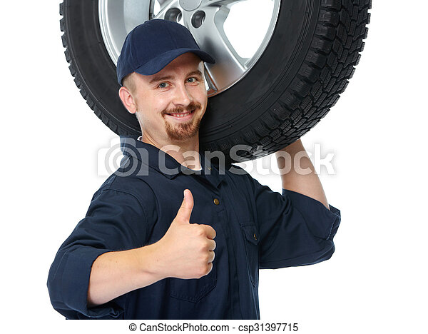 Car mechanic with a tire. - csp31397715