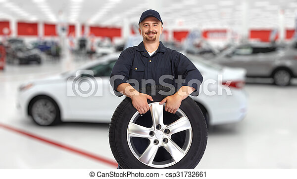 Car mechanic with a tire. - csp31732661