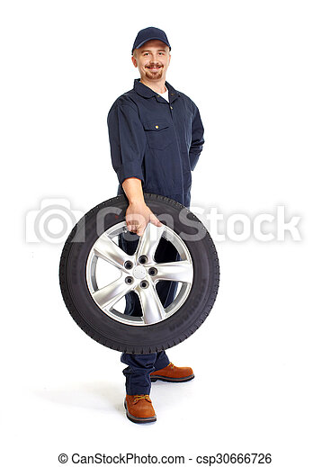 Car mechanic with a tire. - csp30666726
