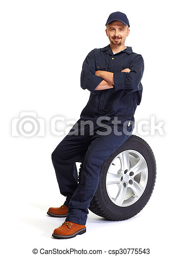 Car mechanic with a tire. - csp30775543