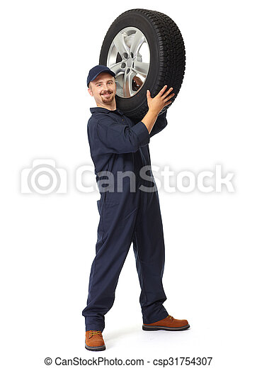 Car mechanic with a tire. - csp31754307