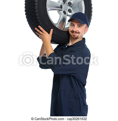 Car mechanic with a tire. - csp30261632