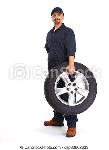 Car mechanic with a tire. - csp30602633