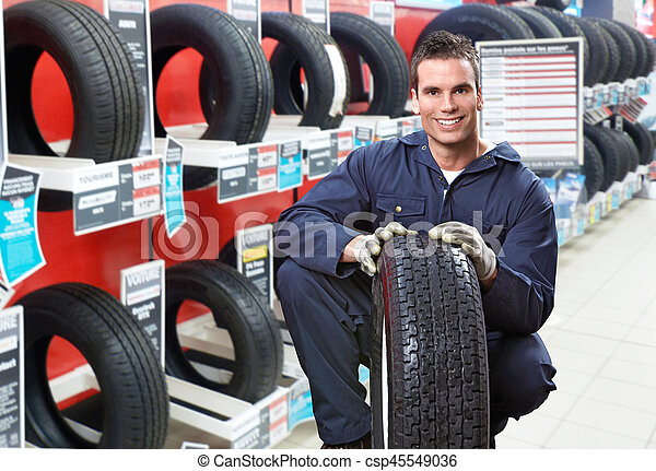 Car mechanic with tire - csp45549036