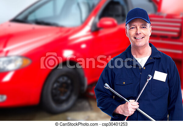 Car mechanic with tire wrench. - csp30401253