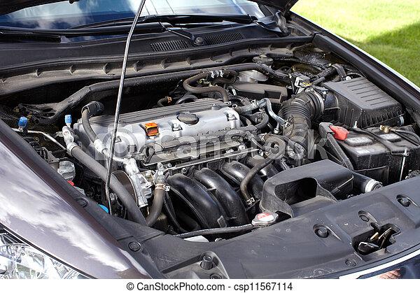 Car mechanic working in auto repair service. - csp11567114
