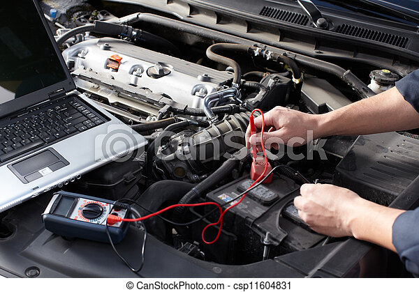 Car mechanic working in auto repair service. - csp11604831