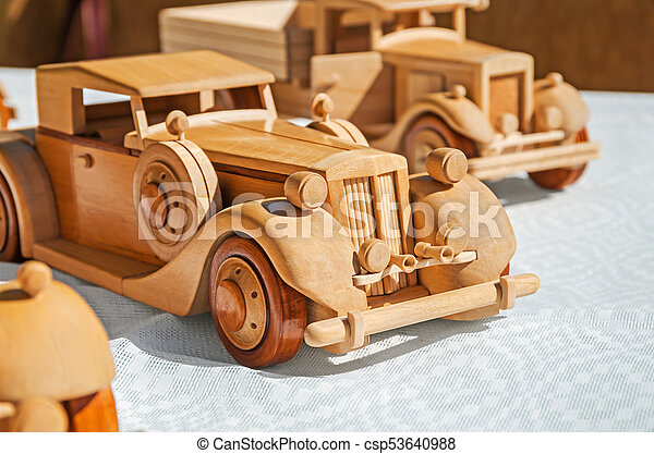 car model wooden wooden model of retro executive cars on a white