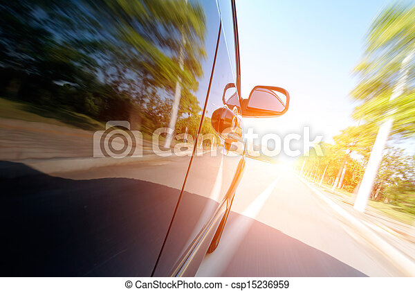 car on the road with motion blur background - csp15236959
