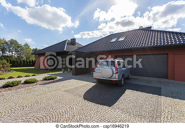 Car parked in front of a house - csp16946219