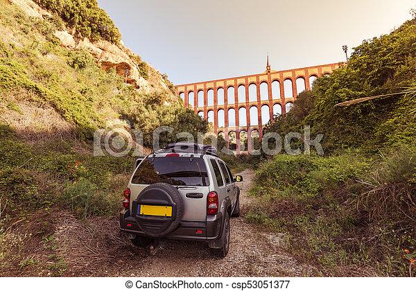 Car parked off road by Nerja Roman bridge, Spain - csp53051377