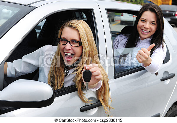 car rental: women driving a new car - csp2338145