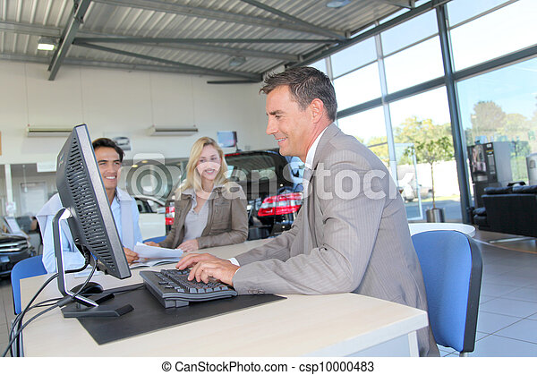 Car seller and couple of buyers signing contract - csp10000483