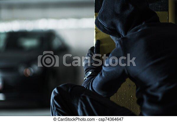 Car Thief Taking Action - csp74364647