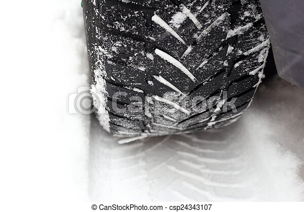 car tire in the snow - csp24343107