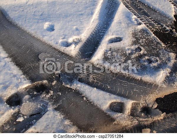 Car tire track in snow - csp27051284