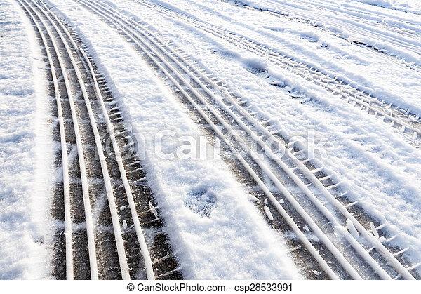 Car tire tracks in snow - csp28533991