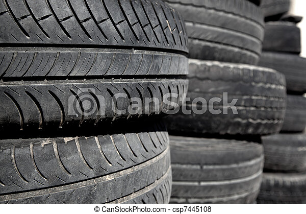 car tires pneus stacked in rows - csp7445108