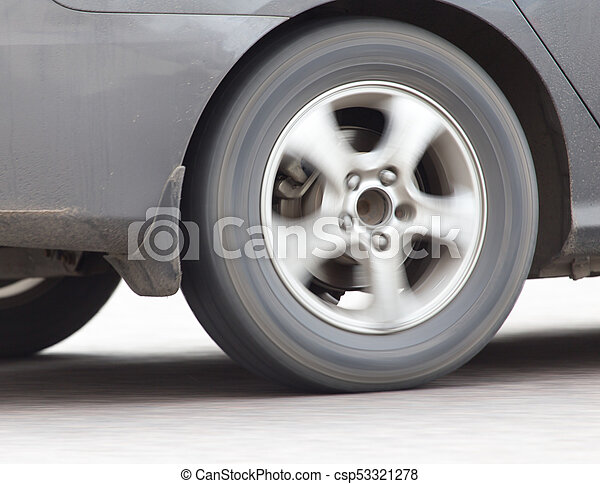 car wheel in motion on the road - csp53321278