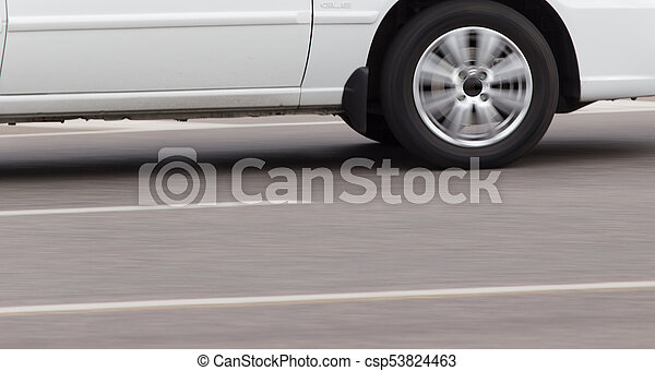 car wheel in motion on the road - csp53824463