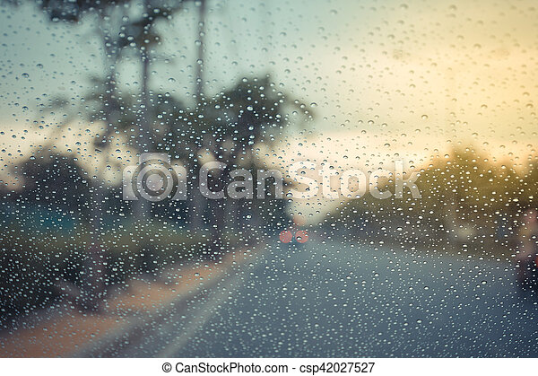 Car windscreen glass and rain water drops - csp42027527