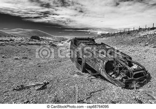 Car wreck near the road in Patagonia - csp68764095