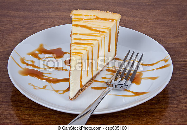 Caramel Drizzled Cheesecake on a Plate - csp6051001