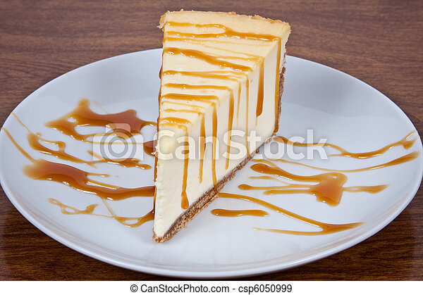 Caramel Drizzled Cheesecake on a Plate - csp6050999
