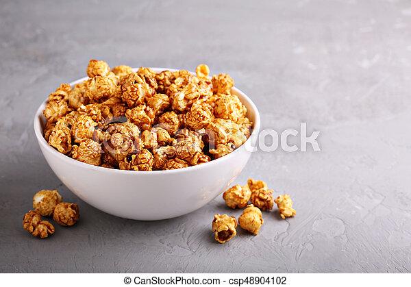 Caramel popcorn in a bowl - csp48904102